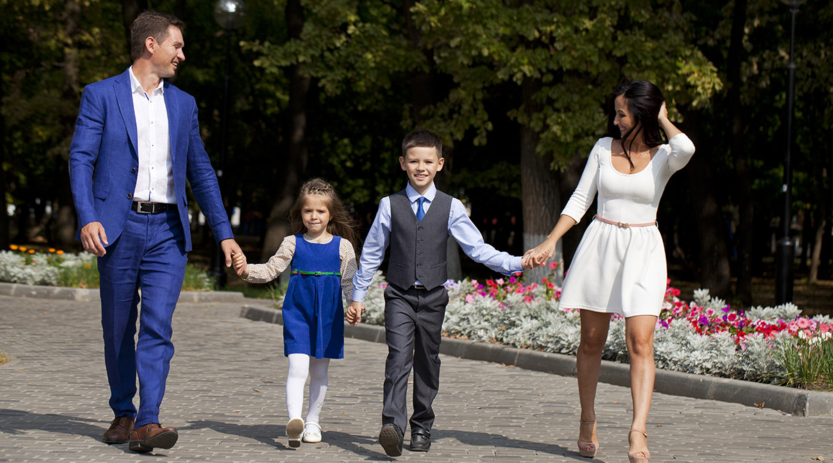 Happy Family Walking Along Suburban Street
